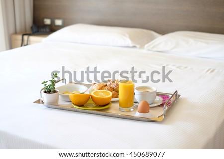 Continental breakfast coffee milk orange juice and croissant - stock photo
