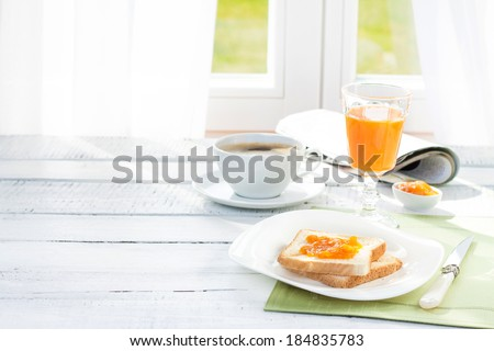 Continental breakfast - coffee, orange juice and toast on white wood table. Background with free text space. - stock photo
