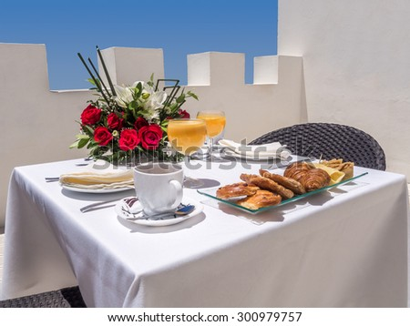 Continental breakfast on a terrace - stock photo