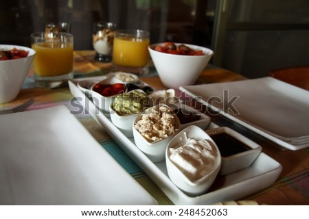 continental style breakfast with tuna salad and orange juice  - stock photo