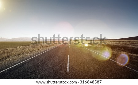 Continuous Road Scenic Mountain Ranges Concept - stock photo