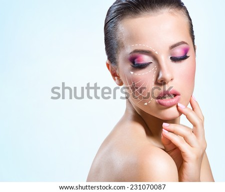 Contour lines on the girl face, blue background. Concept of beauty and treatment - stock photo
