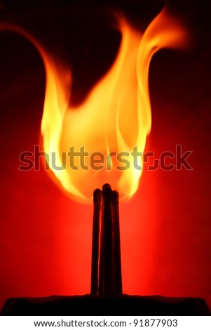contour matches burning on red background - stock photo