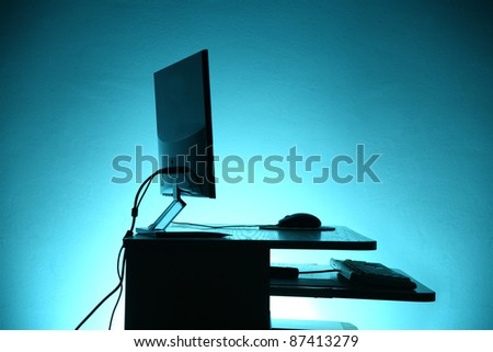 contours of PC isolated on blue background - stock photo