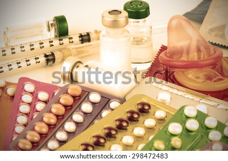 Contraception Education Concept with Oral contraceptive, Emergency Pills, Injection Contraceptive and Male Condom. - stock photo