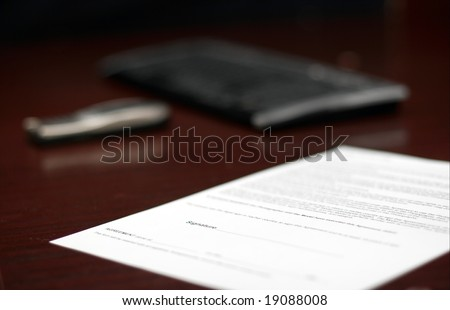 Contract on a table, shallow DoF - stock photo