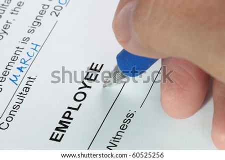 Contract signing of an employment contract close-up shot - stock photo