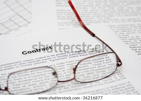 Contract with glasses ready to be read - stock photo