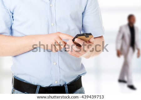 Contractor in hardhat using his cell phone - stock photo