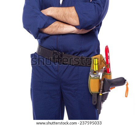 Contractor standing with toolbelt on white background - stock photo