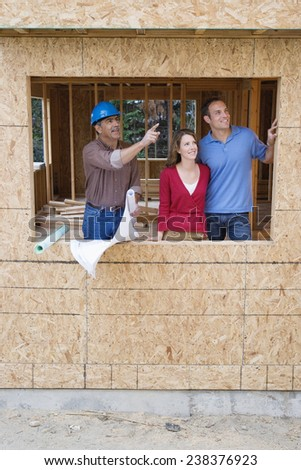 Contractor Talking to Homeowners - stock photo