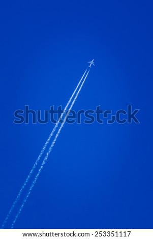 Contrail In Blue Sky. Plane, Clear Sunny Sky Background - stock photo