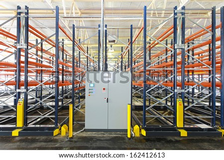 Control box of mobile shelving system in warehouse - stock photo