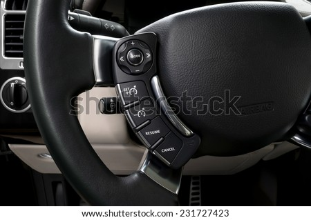 Control buttons on steering wheel. Car interior. - stock photo
