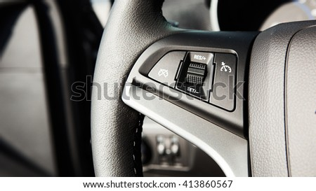Control buttons on the steering wheel - stock photo