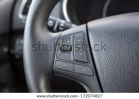 Control buttons on the steering wheel of a car - stock photo