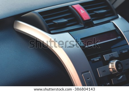 control panel and cd in a modern car, Vintage style processed - stock photo