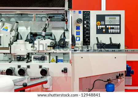 Control panel and interior of woodworking machinery - stock photo