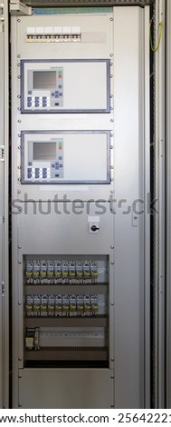 Control panel in modern electrical substation - stock photo