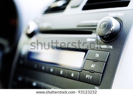 control panel of audio player and other devices of the car - stock photo