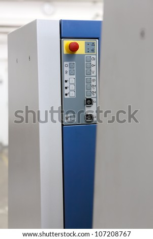 Control panel with big red stop button - stock photo
