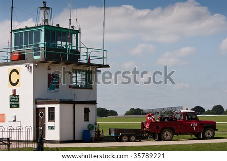 Control tower with land rover fire truck parked at the ready - stock photo