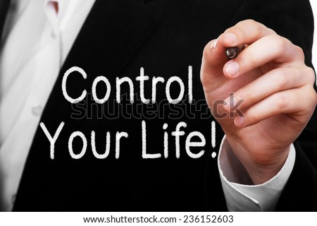 Control your life! Man writing a motivational message text on transparent glass - stock photo