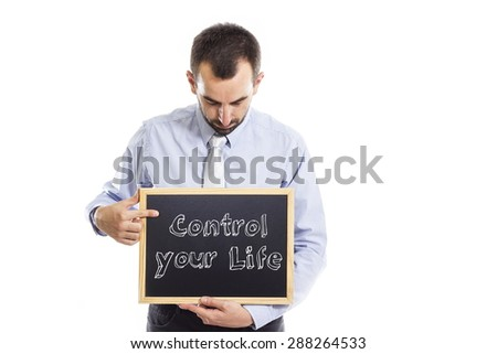Control your life - Young businessman with blackboard - isolated on white - stock photo