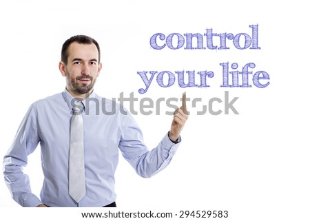 Control your life  Young businessman with small beard pointing up in blue shirt - stock photo