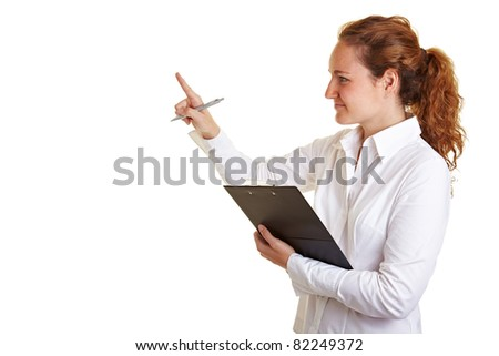 Controller woman checking list on clipboard and counting items - stock photo