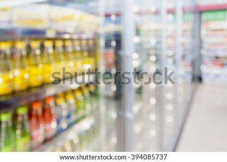 convenience store refrigerator shelves blurred background - stock photo