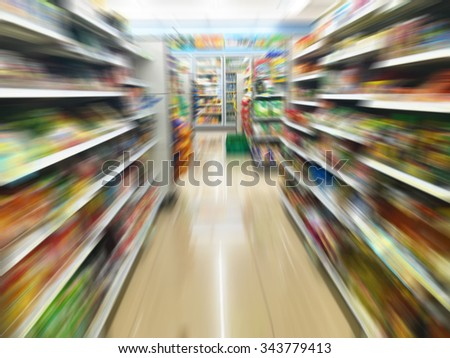 convenience store shelves with motion blur - stock photo