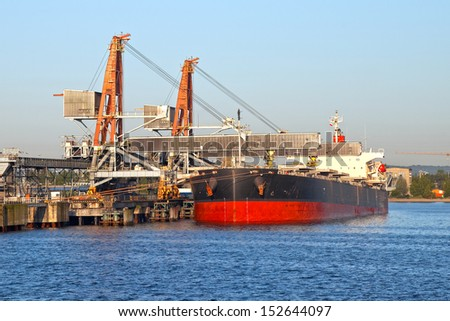 Conveyor and big crane -  ready for loading coal on ship. - stock photo