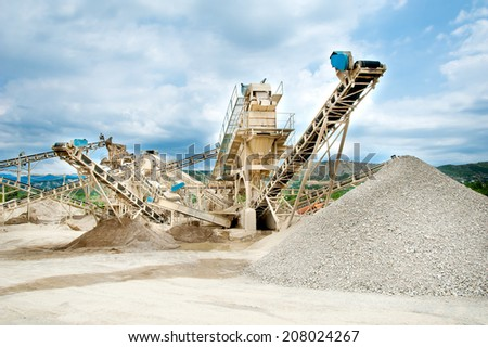 conveyor at the reprocessing plant of stones in career  - stock photo