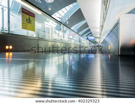 conveyor belt at airport terminal, blured - stock photo