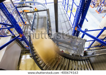 Conveyor belt in a modern warehouse - stock photo