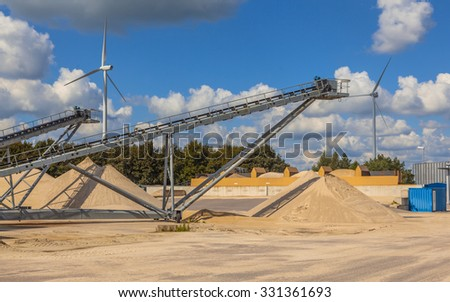 Conveyor belts in an installation for sorting and washing sand for concrete production and construction activities - stock photo