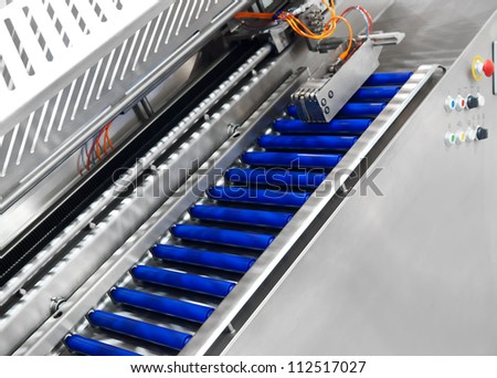 Conveyor - part of industrial equipment - stock photo