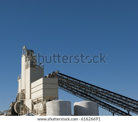conveyors and silos at a cement factory - stock photo
