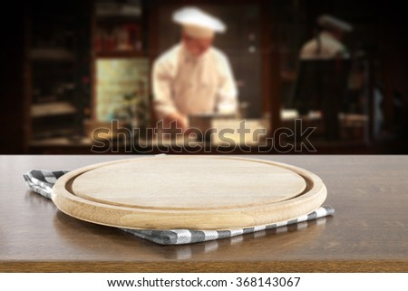 cook and restaurant interior with glasses brown desk space  - stock photo