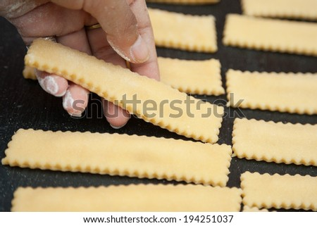 Cook finishing up the preparation of fresh  ravioli - stock photo