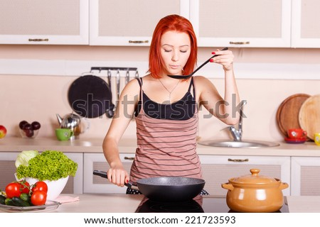 Cook food on the stove. Young girl fries and cooks the food in the pan. Cook healthy food. Electric stove for cooking. Woman housewife sweat lunch, breakfast, dinner. Vegetables for eating, cooking. - stock photo