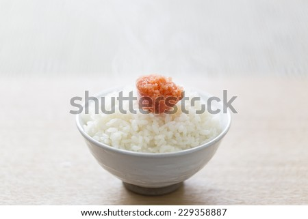Cook fresh rice, the Japanese specialty of cod roe - stock photo