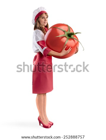 cook girl chef holding a large tomato on white isolated background - stock photo