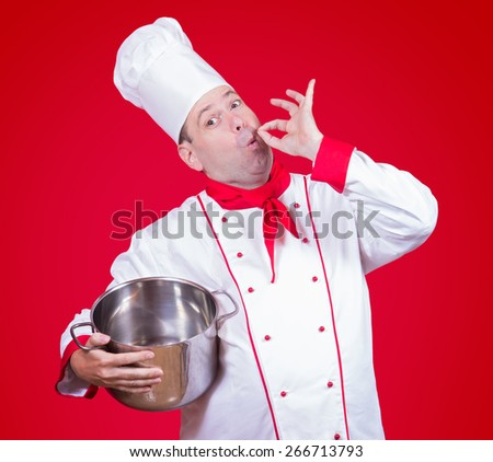 cook holding a pot with gesture okay - stock photo