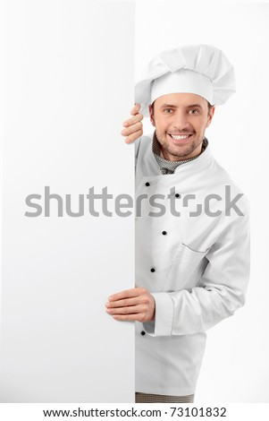 Cook holds a blank banner - stock photo