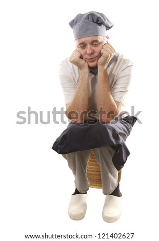 Cook is tired and sad - stock photo