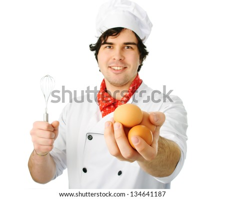 Cook man holds eggs on awhite background - stock photo