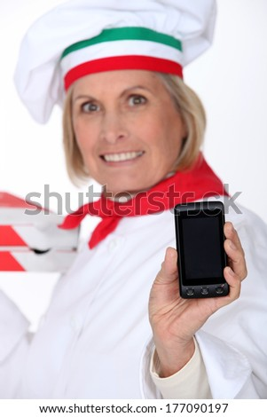 Cook showing phone - stock photo
