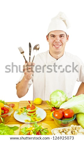 cook shred fruit and vegetables on wooden table at kitchen isolated on white background chef's hand with a knife, spoon and fork - stock photo